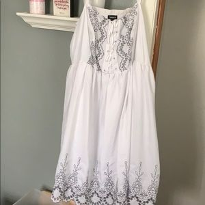 White dress with grey lace design